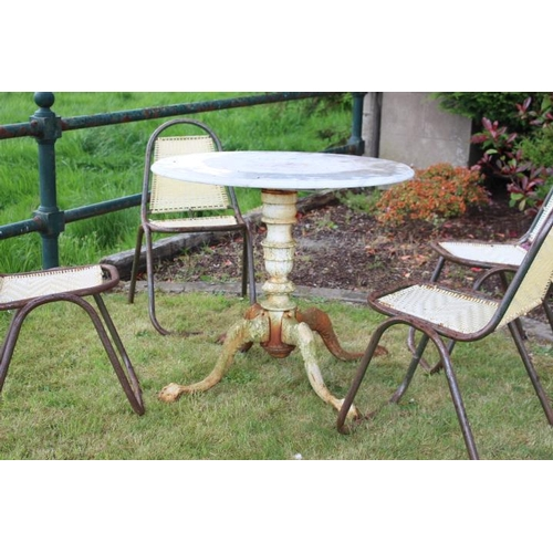 29 - Decorative garden table with circular marble top raised on cast iron pod base with four out swept le...