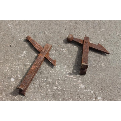 332 - Two 19th C. cast iron gate holders....