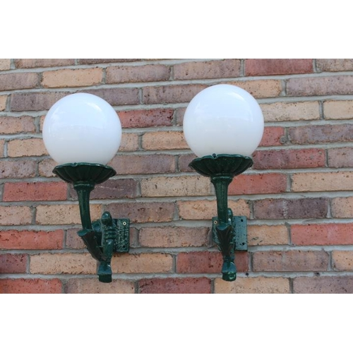 386 - Pair of green aluminium wall light with milk glass football shade {40 cm H x 25 cm W x 40 cm D each}...