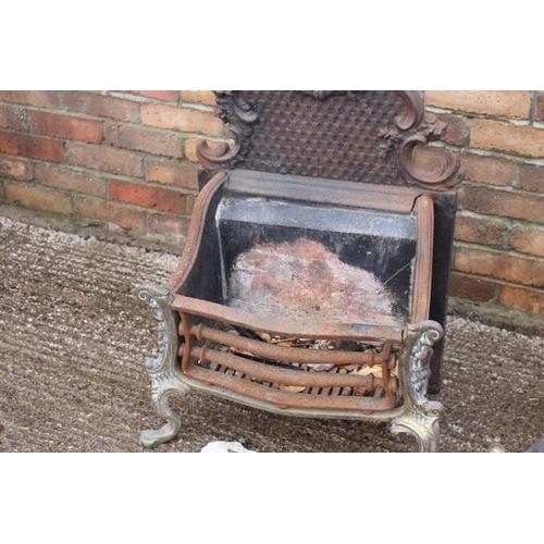 39 - Three decorative cast iron free standing fire grates {1.  75 cm H x 50 cm W x 30 cm D, 2.  40 cm H x...