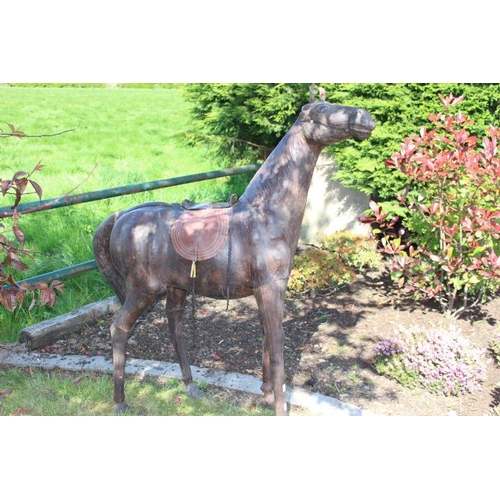 392 - Large leather model of a horse {140 cm H x 110 cm W x 80 cm D}....