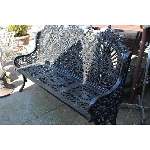 395 - Decorative cast iron three seater garden bench {120 cm H x 180 cm W x 60 cm D}....