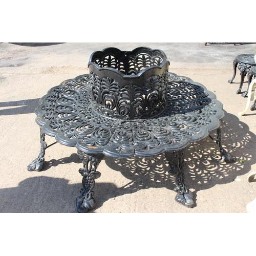 397 - Decorative cast iron circular tree garden seat {75 cm H x 60 cm Dia centre x 180 cm Dia external}....