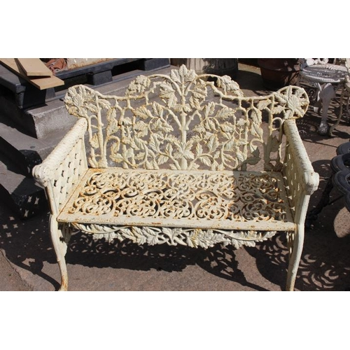 399 - Decorative cast iron two seater garden bench the arms terminating with ram heads {84 cm H x 106 cm W...