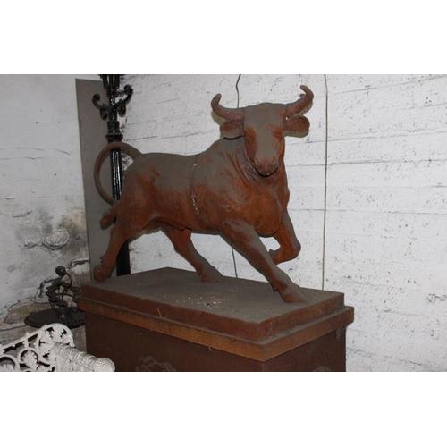 401 - Pair of cast iron Bull's mounted on plinths {190 cm H x 130 cm W x 60 cm D}....