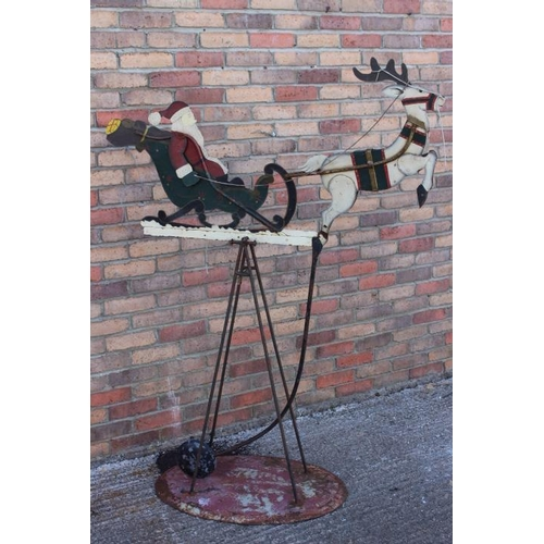 412 - Metal swinging Santa Clause and Reindeer scene on stand {150 cm H x 120 cm W x 55 cm D}....