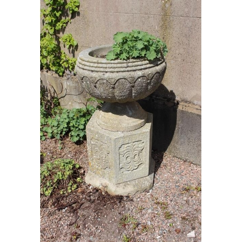 420 - Pair of circular sandstone planters mounted on hexagonal plinths {102 cm H x 60 cm Dia.}....
