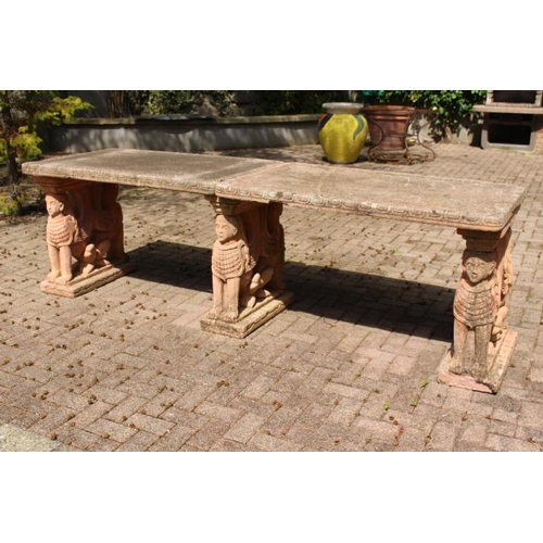 433 - Terracotta garden table raised on three supports decorated with Sphinx {80 cm H x 260 W x 80 cm D}....