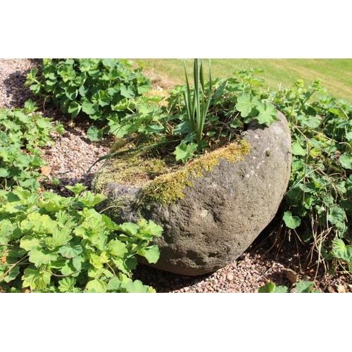 450 - 19th C. sandstone whinstone {55 cm H x 70 cm Dia}....