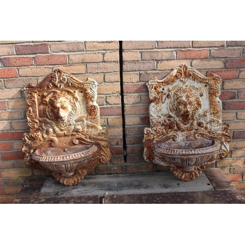 460 - Pair of cast iron wall water fountains decorated with Lions masks {80 cm H x 60 cm W x 26 cm D each}...