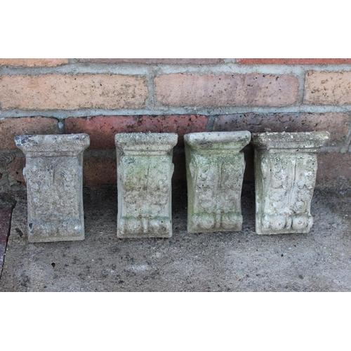 468 - Set of four composition corbels decorated with acanthus leaf {19 cm H x 10 cm W x 8 cm D each}....
