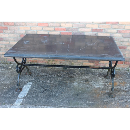 490 - Garden table with marble top on metal scrolled supports and stretcher {72 cm H x 150 cm W x 90 cm D}...