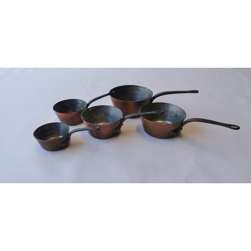 506 - Good quality set of five graduating copper saucepans....