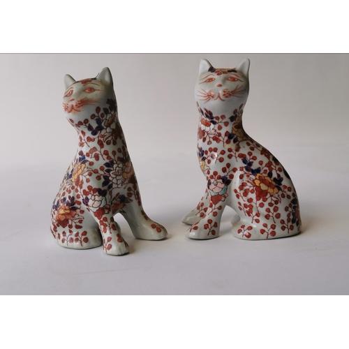 522 - Pair of Oriental ceramic seated cats. { 15cm H }....