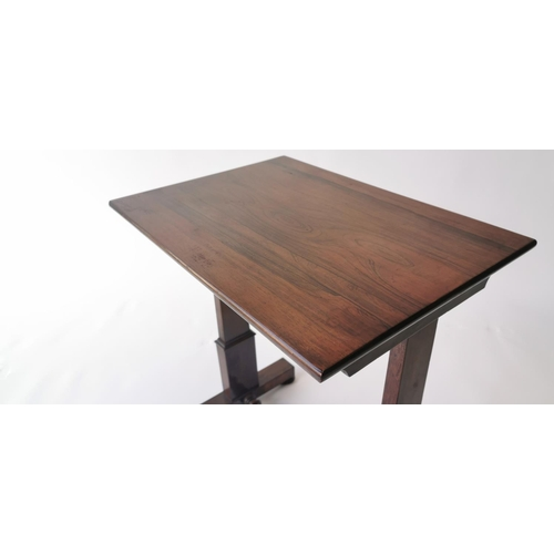 524 - Regency rosewood lamp table, raised on tapering supports with turned stretcher and bun feet. { 55cm ...