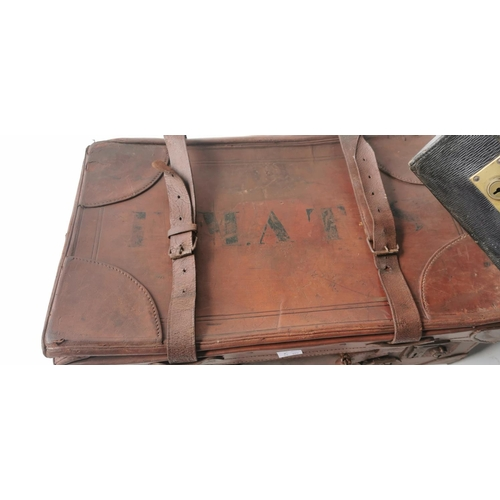 531 - Two leather suitcases  - one for Harrods....
