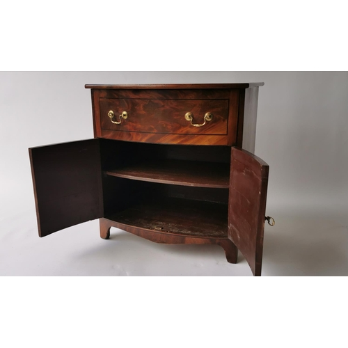 534 - Regency mahogany bow fronted side cabinet, inlaid with ebony, the single drawer above two doors. { 6...