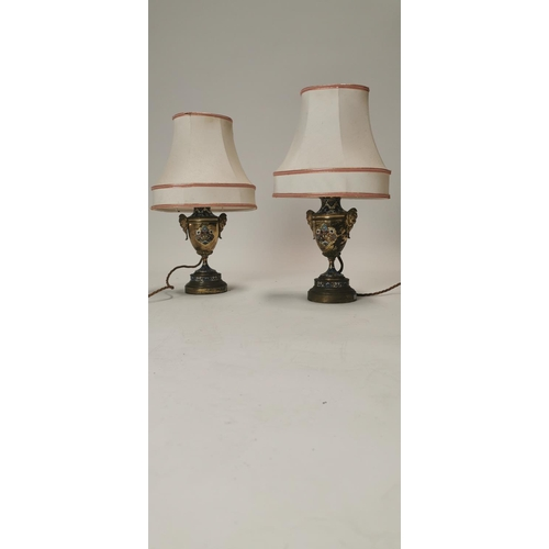 540 - Pair of early 20th. C. brass and cloisonné table lamps of baluster form the handles in the form of a...