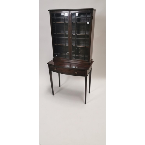 553 - Georgian mahogany bookcase on stand, the two astragal glazed doors above a single drawer raised on t...