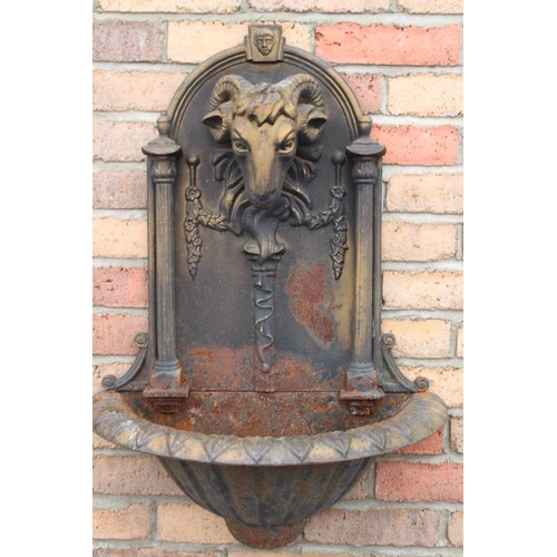 58 - Pair of cast iron  wall water fonts decorated with rams heads, swags and columns {80 cm H x 60 cm W ...