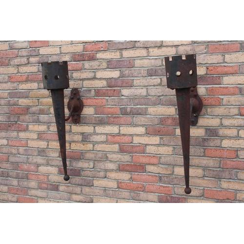 69 - Pair of medieval style wall ensconces {96 cm H x 23 cm W x 36 cm D each}....