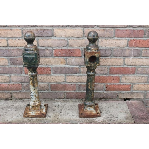 71 - Pair of cast iron posts {63 cm H x 16 cm Sq.}....