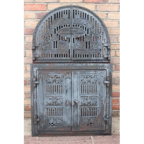 72 - Decorative 19th. C. cast iron arched furnace doors {124 cm H x 76 cm D x 16 cm D}....