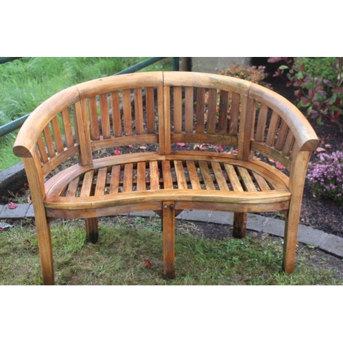 90 - Two seater teak garden bench with shaped back. {80 cm H x 114 cm W x 50 cm D}....