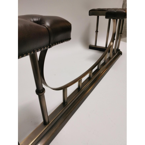 10 - Good quality brushed brass and leather club fender {50 cm H x 172 cm W x 49 cm D}....