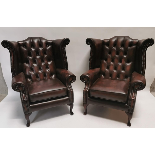 37 - Pair of leather wingback armchairs {103 cm H x 89 cm W x 84 cm D}....