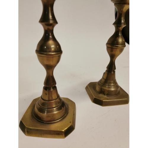 57 - Pair of brass candle sticks {25 cm H}....