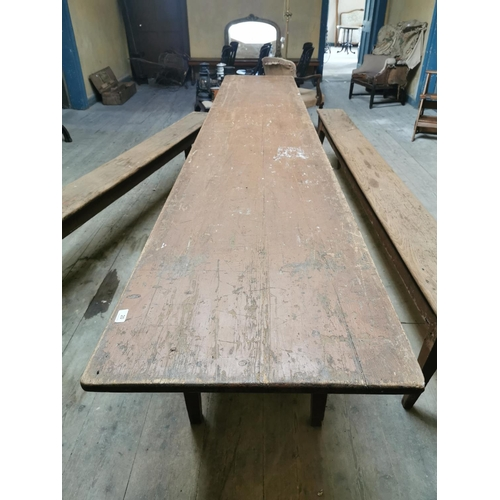 20 - 19th. C. scumbled pine kitchen table raised on four tapered legs. {74 cm H x 350 cm L x 64 cm D}....