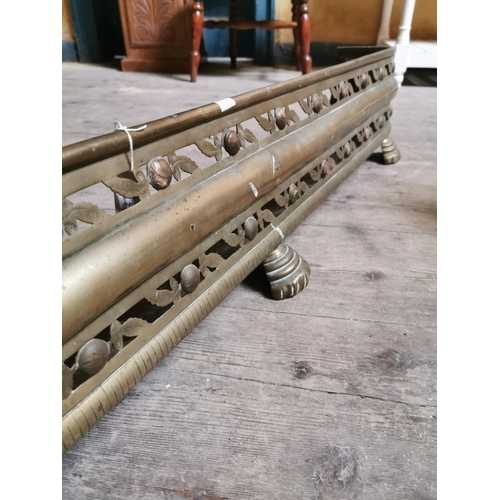 23 - Georgian brass pierced fender. {24 cm H x 140 cm W x 18 cm D}....