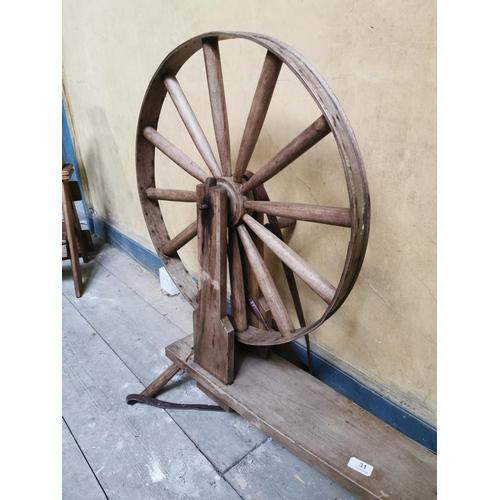31 - 19th. C. spinning wheel. { 87cm H X 92cm W X 13cm D }....