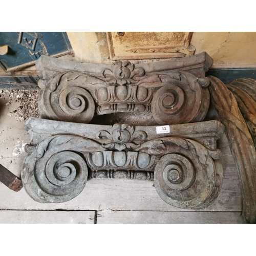33 - Pair of Georgian bronze Corinthian column tops decorated with C scrolls, acanthus leaves and flowers...