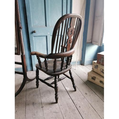 46 - 19th. C. elm and oak Windsor armchair. {115 cm H x 70 cm W x 54 cm D}...