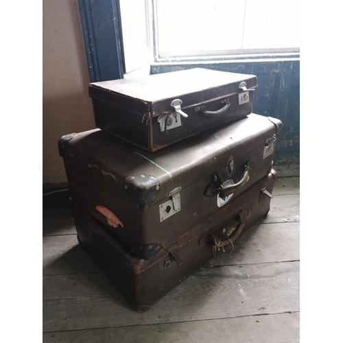 49 - Three brown leather suitcases....