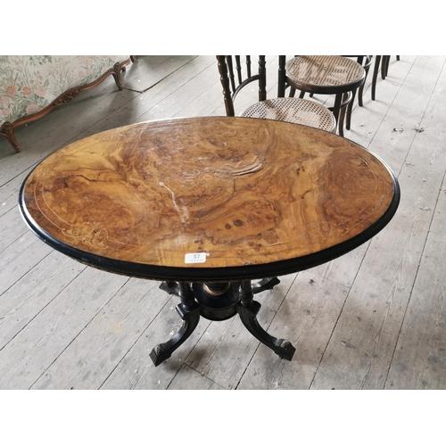 57 - Inlaid mahogany occasional table of oval form raised on ebonised base .{73 cm H x 88 cm w x 66 cm ....