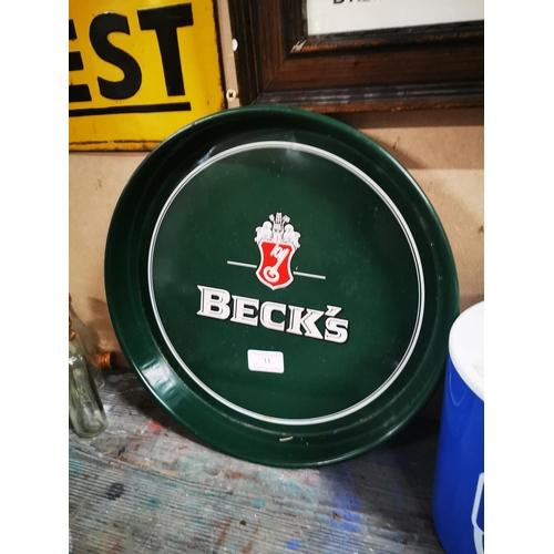 11 - Beck's tinplate advertising tray. { 33cm Dia. }...