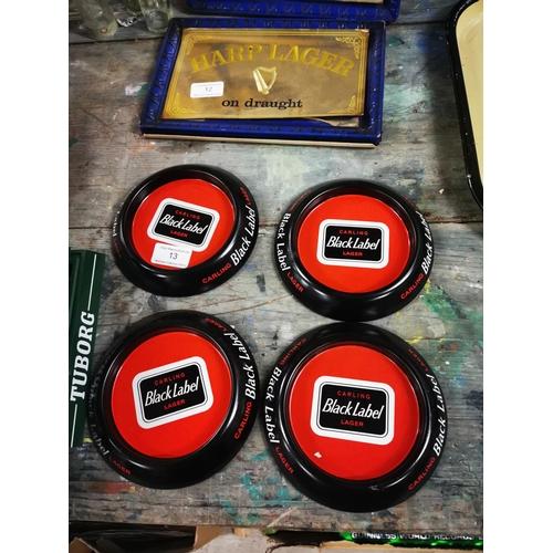13 - Four tinplate Black Label advertising ashtrays....