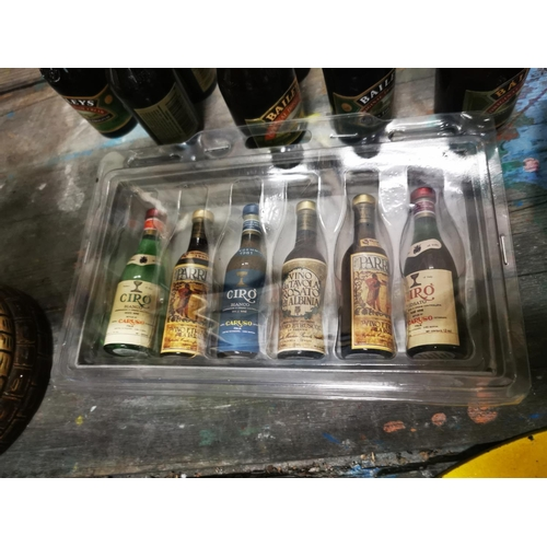 38 - Collection of miniature Baileys & Irish Coffee bottles  - some with contents and a game of Truth or ...