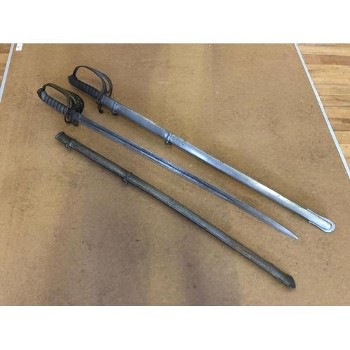 12 - Pair of steel swords by Wilkinson London L 107...