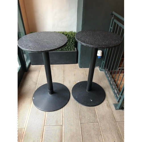 15 - Pair of circular tall restaurant tables with polished granite tops on metal bases W 55cm H 95cm...