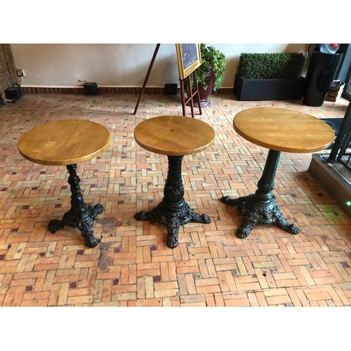 3 - Three Graduated restaurant tables with decorative cast iron bases Largest W 60cm H 75cm...