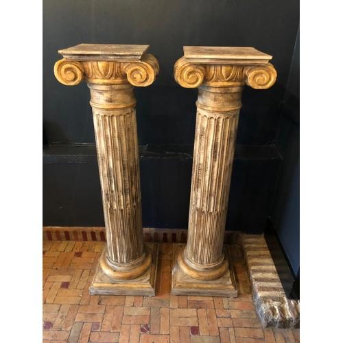 39 - Pair of carved wood painted plinths of Corinthian form W 46cm H 124cm D 37cm...
