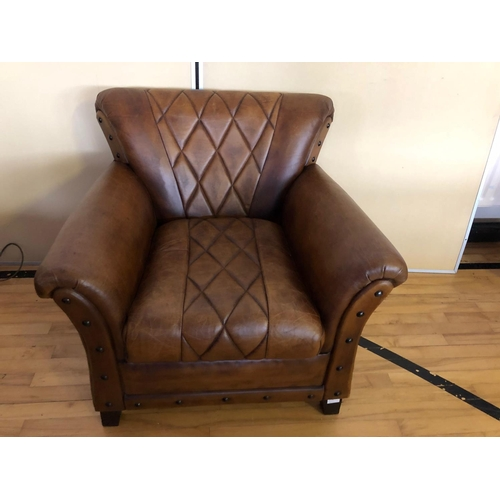 45 - Fine leather armchair with geometric pattern and deep buttoned embellishment W 90cm H 80cm D 80cm...
