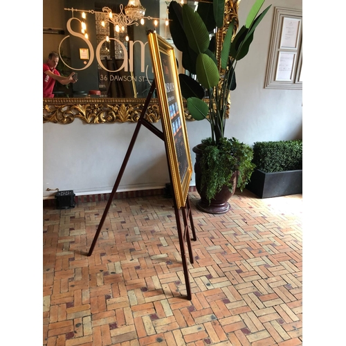 8 - Easel complete with framed gold advertisement W 75cm H 150cm...