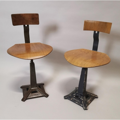 16 - Pair of early 20th C. Singer machinist's chairs {87 cm H x 45 cm W x 41 cm D}....