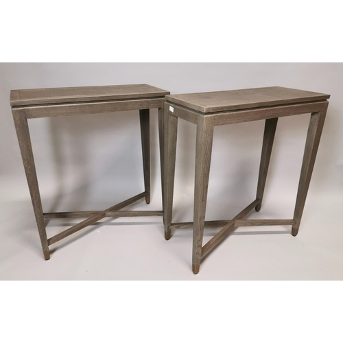 35 - Pair of stylish bleached oak side tables with brass inlay on square tapered legs and X-frame support...