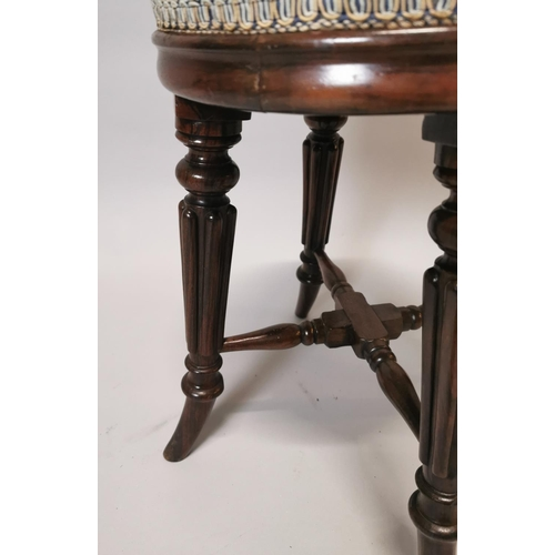39 - Good quality William IV flamed mahogany piano stool with upholstered seat {51 cm H x 35 cm Dia.}....
